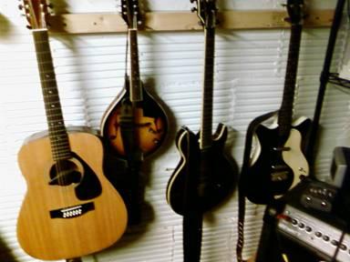 L-R: Yamaha 12-string, Fender A-style mandolin, Schecter Elite, Danelectro 59.