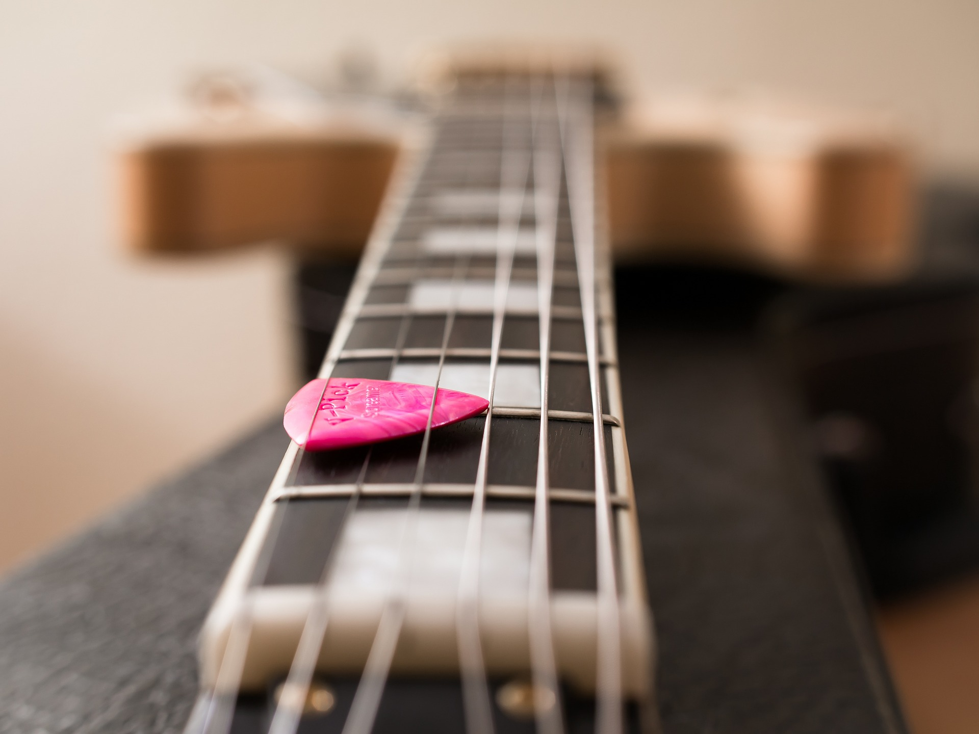should you learn to play on acoustic or electric guitar. Black Bedroom Furniture Sets. Home Design Ideas